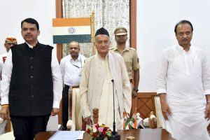 Mumbai: Maharashtra Governor Bhagat Singh Koshyari flanked by newly-appointed Chief Minister of Maharashtra Devendra Fadnavis and his Deputy CM Ajit Pawar, during an oath-taking ceremony, in Mumbai, Saturday, Nov. 23, 2019. (PTI Photo) (PTI11 23 2019 000027B)
