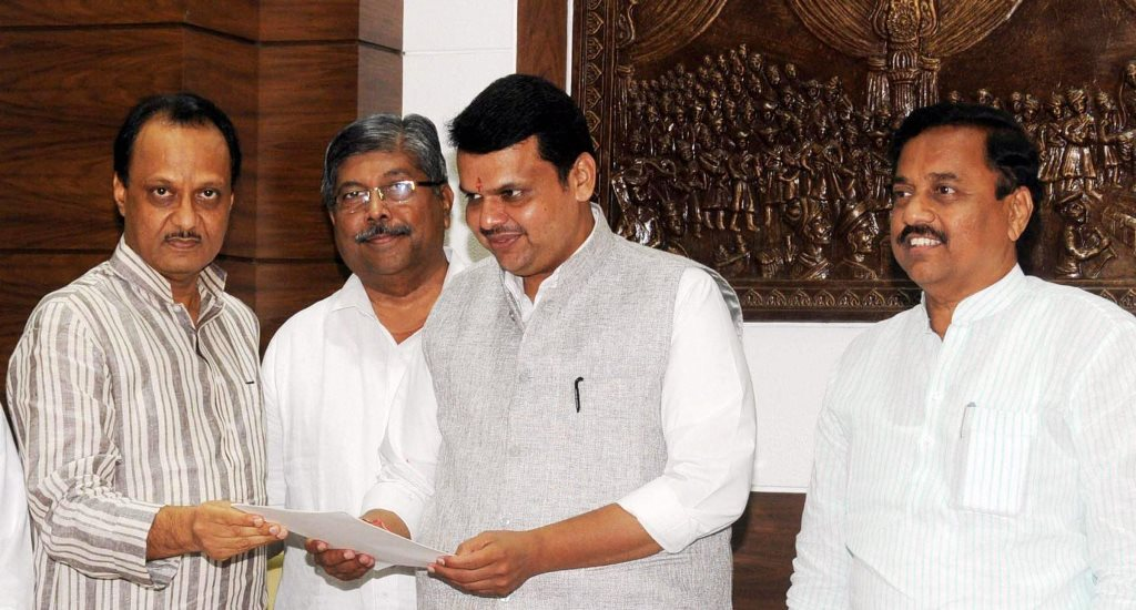 **EDS: FILE PHOTO** Mumbai: In this Nov. 30, 2014 file photo, NCP leaders Ajit Pawar with Maharastra Chief Minister Devendra Fadnavis in Mumbai. BJP's Devendra Fadnavis took oath as the Maharashtra Chief Minister for a second term at Raj Bhavan on Saturday, Nov. 23, 2019. The National Conference Party's Ajit Pawar was sworn in as his deputy. (PTI Photo)(PTI11_23_2019_000160B)