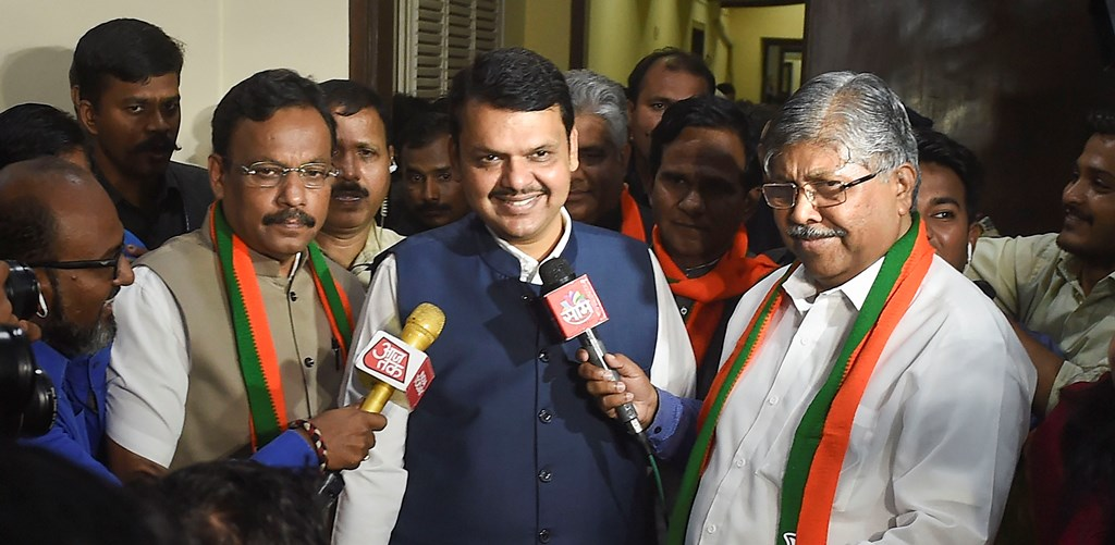 Mumbai: Maharashtra Chief Minister Devendra Fadnavis with  BJP Maharashtra President Chandrakant Patil arrives for the BJP MLA meeting at Vasant Sruti at Dadar in Mumbai, Sunday, Nov. 24, 2019. (PTI Photo/Mitesh Bhuvad)(PTI11_24_2019_000105B)