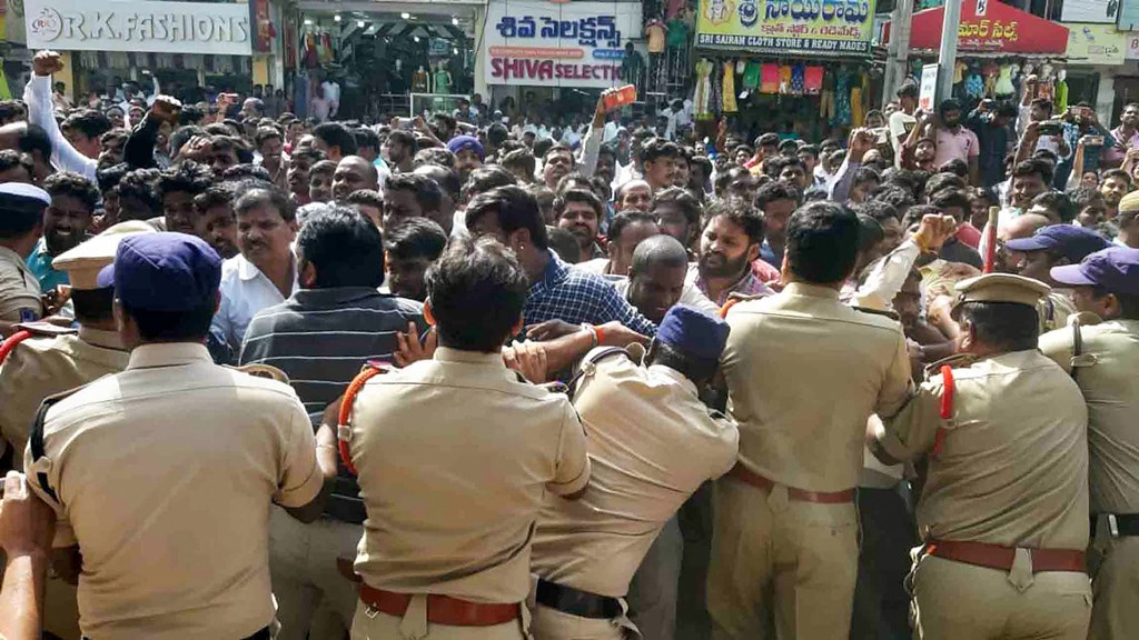 Hyderabad: Protestors and police clash during a demonstration demanding justice for P Priyanka Reddy, who was working as an assistant veterinarian at a state-run hospital and whose charred remains was found under a culvert, in Hyderabad, Saturday, Nov. 30, 2019. (PTI Photo)(PTI11_30_2019_000199B)