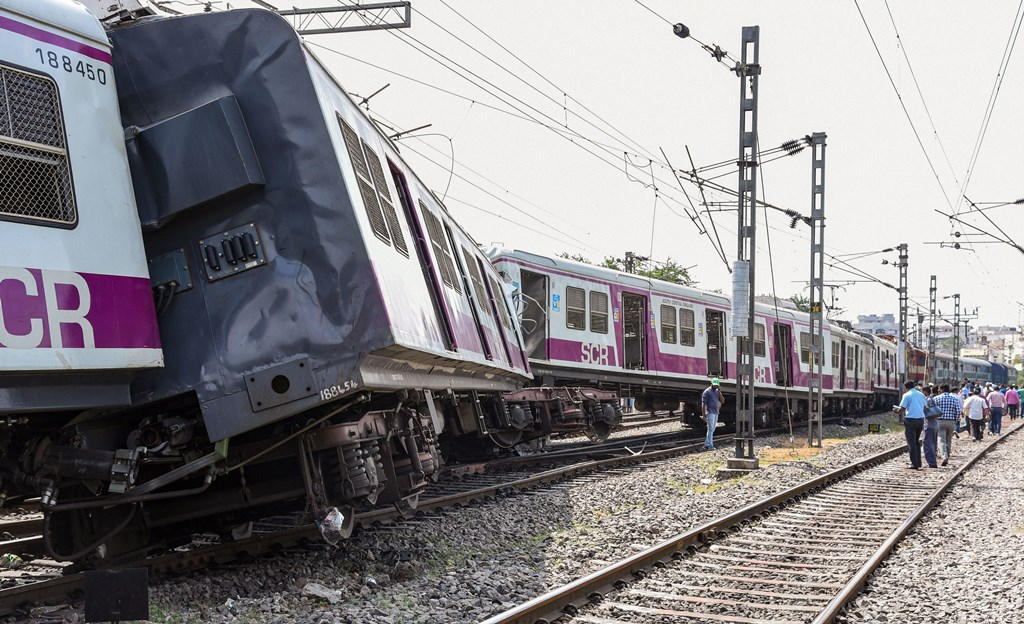 Hyderabad: Onlookers gather at the accident site where a Multi-Modal Transport System (MMTS) train collided with a passenger train between Kacheguda and Malakpet stations, in Hyderabad, Monday, Nov. 11, 2019. (PTI Photo) (PTI11_11_2019_000029B)