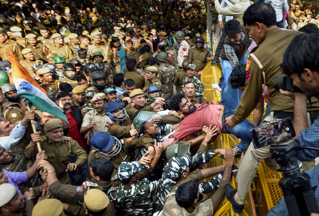 New Delhi: Jawaharlal Nehru University students try to get past a police barricade during a protest march towards Parliament, on the first day of the Winter Session, demanding a total rollback of the hostel fee hike, in New Delhi, Monday, Nov. 18, 2019. The students, who were holding a protest on the university's premises for the last three weeks, hit the streets seeking to get the attention of Parliament about their demands, asserting they will not relent until the government withdraws the hike. (PTI Photo/Ravi Choudhary)(PTI11_18_2019_000152B)