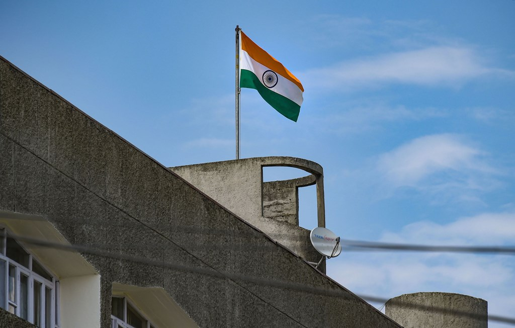 """Srinagar: Indian tricolour flag flies atop Civil Secretariat, in Srinagar, Oct. 31, 2019. Jammu and Kashmir on Thursday transitioned from a state into two union territories with a wary Valley shutting down as it has for 88 days and Prime Minister Narendra Modi saying the """"new system"""" is aimed at """"building a strong link of trust"""". (PTI Photo/S. Irfan)(PTI10_31_2019_000321B)"""