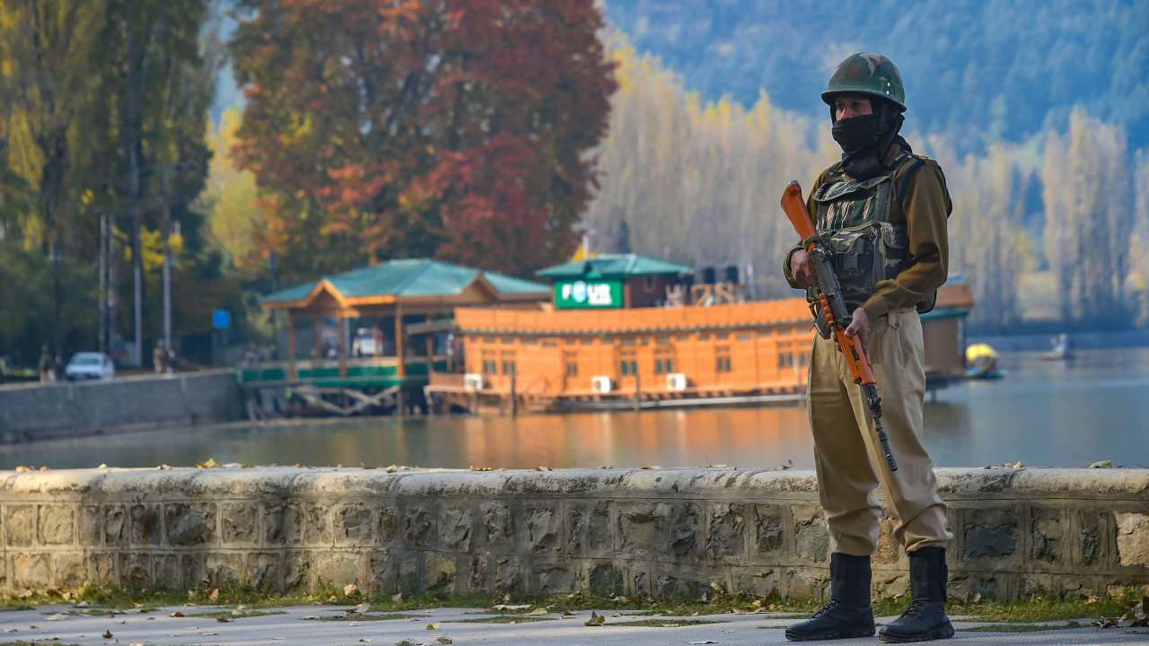 A security person keeps vigil near the Raj Bhawan after bifurcation of the Jammu and Kashmir, in Srinagar on October 31. (Photo: PTI)