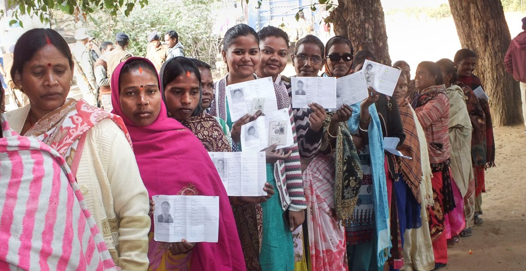 Latehar: People wait in queues to cast their votes at a polling station during the first phase of Jharkhand Assembly elections in Maoist-hit Latehar district, Saturday, Nov. 30, 2019. (PTI Photo) (PTI11_30_2019_000018B)