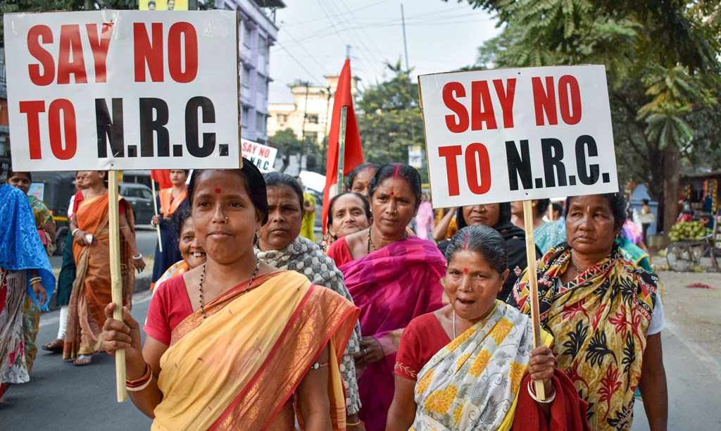 Siliguri: Activists hold placards as they protest against the implementation of the National Register of Citizens (NRC), in Siliguri, Friday, Nov. 29, 2019. (PTI Photo) (PTI11_29_2019_000264B)