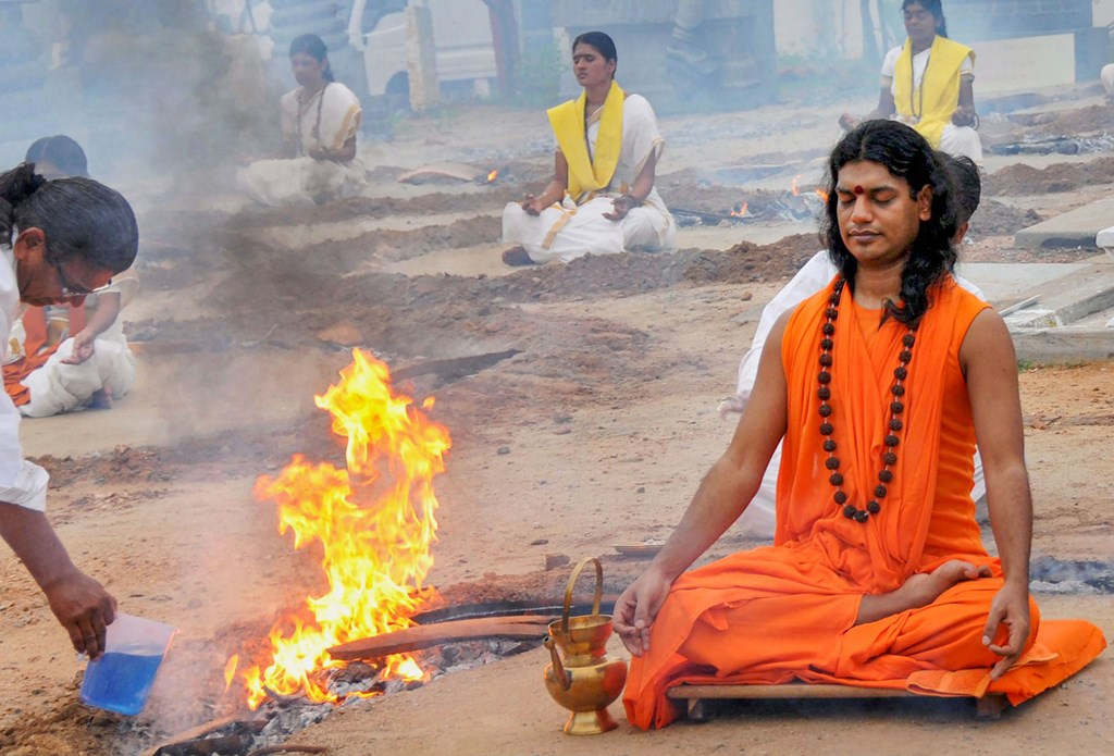 **EDS: FILE PHOTO** Bangalore: In this June 13, 2010 file photo, self-styled godman Swami Nithyananda performs a ritual with his disciples at his ashram after being released on bail from Ramnagaram Jail near Bangalore. An FIR was registered against Nithyananda on the charges of alleged kidnapping and wrongful confinement of children to make them collect donations from followers to run his ashram in Ahmedabad on Wednesday, Nov. 20, 2019. Police also arrested Sadhvi Pranpriyananda and Priyatatva Riddhi Kiran, both women disciples of the controversial godman. (PTI Photo/ Shailendra Bhojak)(PTI11_20_2019_000186B)