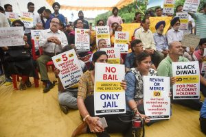 Mumbai: Account-holders of the Punjab and Maharashtra Co-operative Bank (PMC) display placards during a protest over the Reserve Bank of India (RBI)'s curb on the bank, at Azad Maidan, in Mumbai, Tuesday, Oct. 22, 2019.  (PTI Photo/Shashank Parade)(PTI10_22_2019_000071B)