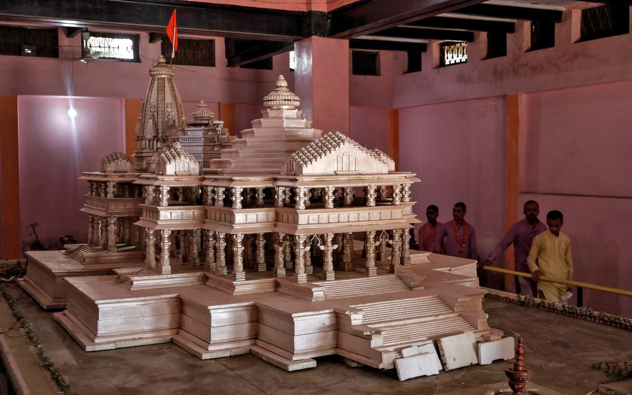 Devotees look at a model of the proposed Ram temple that Hindu groups want to build at a disputed religious site in Ayodhya, India, October 22, 2019. REUTERS/Danish Siddiqui