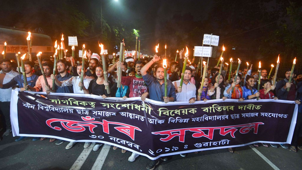 Guwahati: Students of Cotton University participate in a torch rally in protest against the Citizenship Amendment Bill (CAB), in Guwahati, Saturday, Nov. 30, 2019. (PTI Photo)(PTI11_30_2019_000173B)