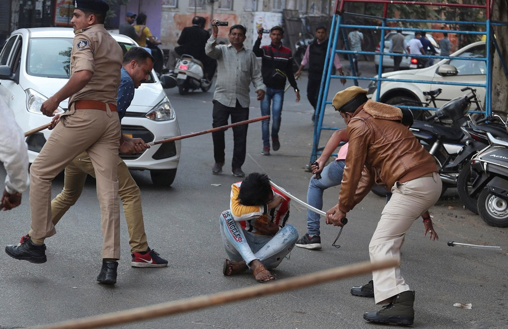 Ahmadabad: Indian policemen baton charge a man during a protest against a new citizenship law in Ahmadabad, India, Thursday, Dec. 19, 2019. Police detained several hundred protesters in some of India's biggest cities Thursday as they defied a ban on assembly that authorities imposed to stop widespread demonstrations against a new citizenship law that opponents say threatens the country's secular democracy. AP/PTI(AP12_19_2019_000318B)