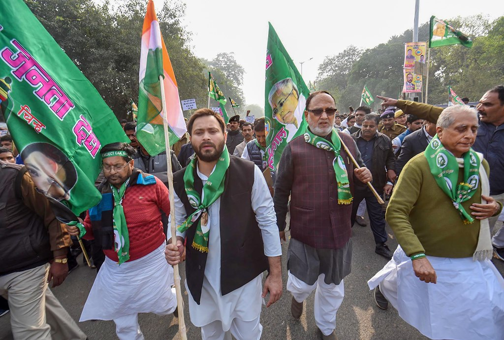 Patna: RJD leader Tejashwi Yadav with supporters raises slogans during a demonstration against NRC and Citizenship (Amendment) Act (CAA), in Patna, Saturday, Dec. 21, 2019. (PTI Photo)(PTI12_21_2019_000061B)