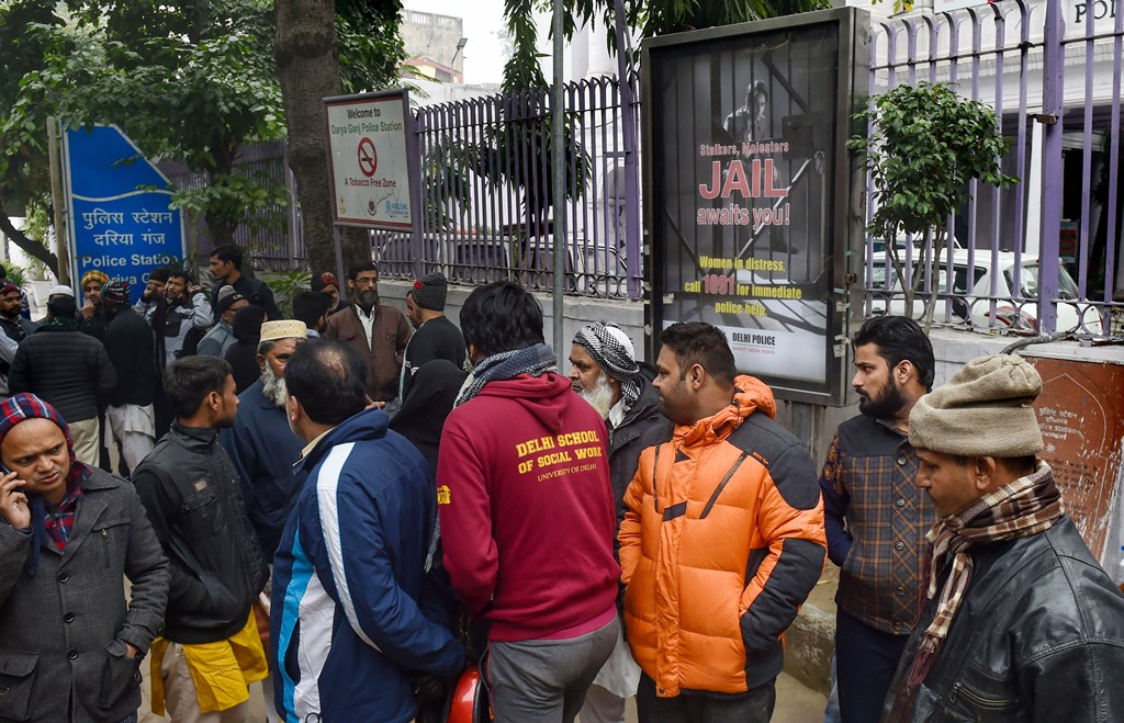 New Delhi: Family members of the people arrested for violence during a rally against the Citizenship Amendment Act (CAA), last evening, wait for their release outside Daryaganj police station, in New Delhi, Saturday, Dec. 21, 2019. (PTI Photo/Manvender Vashist) (PTI12_21_2019_000012B)