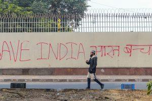 New Delhi: A man walks past anti-Citizenship Amendment Act (CAA) graffiti in New Delhi, Saturday, Dec. 21, 2019. (PTI Photo/Vijay Verma)(PTI12_21_2019_000158B)