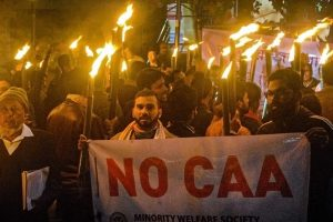 Guwahati: Members of Sanmilata Sangram Parishad take part in a torch light rally in protest against Citizenship Amendment Act (CAA) in Guwahati, Friday, Dec. 20, 2019. (PTI Photo)(PTI12_20_2019_000179B)