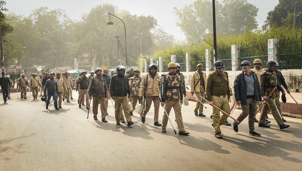 Lucknow: Police personnel deployed outside the historic Tiley Wali Masjid ahead of Friday prayers in view of protests against CAA and NRC, in Lucknow, Friday, Dec. 27, 2019. (PTI Photo/Nand Kumar)(PTI12_27_2019_000100B)