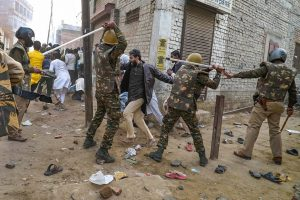 Varanasi: Police personnel baton charge protestors demonstrating against the Citizenship Amendment Act, in Varanasi, Friday, Dec. 20, 2019. (PTI Photo)(PTI12_20_2019_000176B)