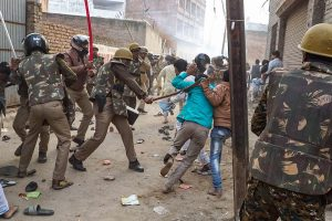Varanasi: Police personnel baton charge protestors demonstrating against the Citizenship Amendment Act, in Varanasi, Friday, Dec. 20, 2019. (PTI Photo)			(PTI12_20_2019_000169B)