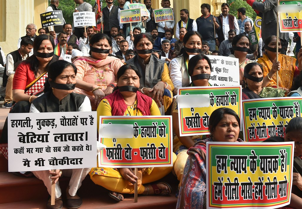 Lucknow: Pragatisheel Samajwadi Party (Lohia) members, wearing black bands, stage a protest against the rape and murder of a veterinarian doctor in Hyderabad last week, in Lucknow, Monday, Dec. 2, 2019. (PTI Photo/Nand Kumar) (PTI12_2_2019_000117B)