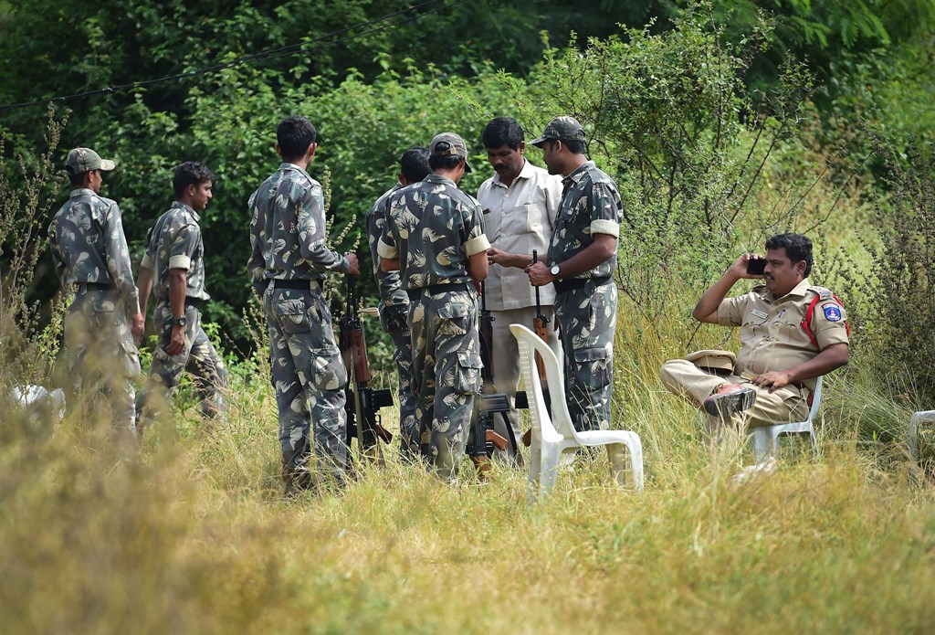 Hyderabad: Security personnel stand guard the area where four accused in the rape-and-murder case of a 25-year-old woman veterinarian were shot dead by police, at Shadnagar of Ranga Reddy district in Hyderabad, Friday, Dec. 6, 2019.  (PTI Photo/Shailendra Bhojak)(PTI12_6_2019_000080B)