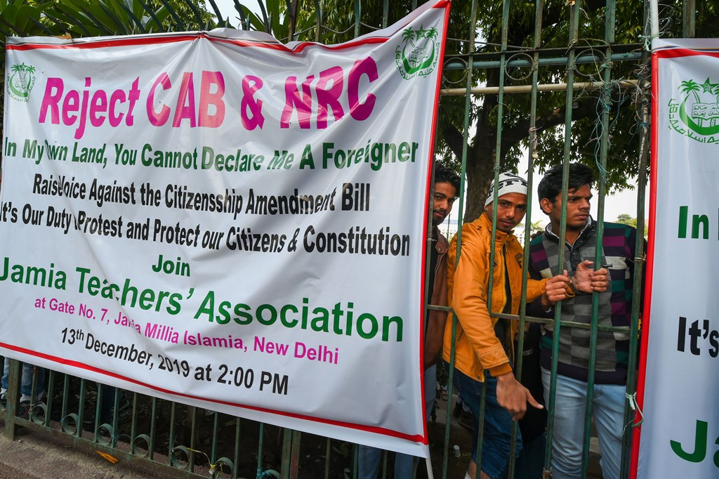 New Delhi: Jamia Teachers' Association puts up a banner against the Citizenship (Amendment) Bill and NRC at the Jamia Millia Islamia in New Delhi, Saturday, Dec. 14, 2019. (PTI Photo/Shahbaz Khan) (PTI12_14_2019_000054B)