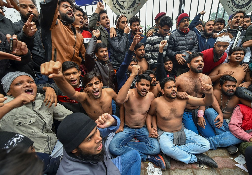 New Delhi: Students protest shirtless at the campus against Delhi Police's action on students at Jamia Millia Islamia yesterday, in New Delhi, Monday, Dec. 16, 2019. (PTI Photo) (PTI12_16_2019_000034B) *** Local Caption ***