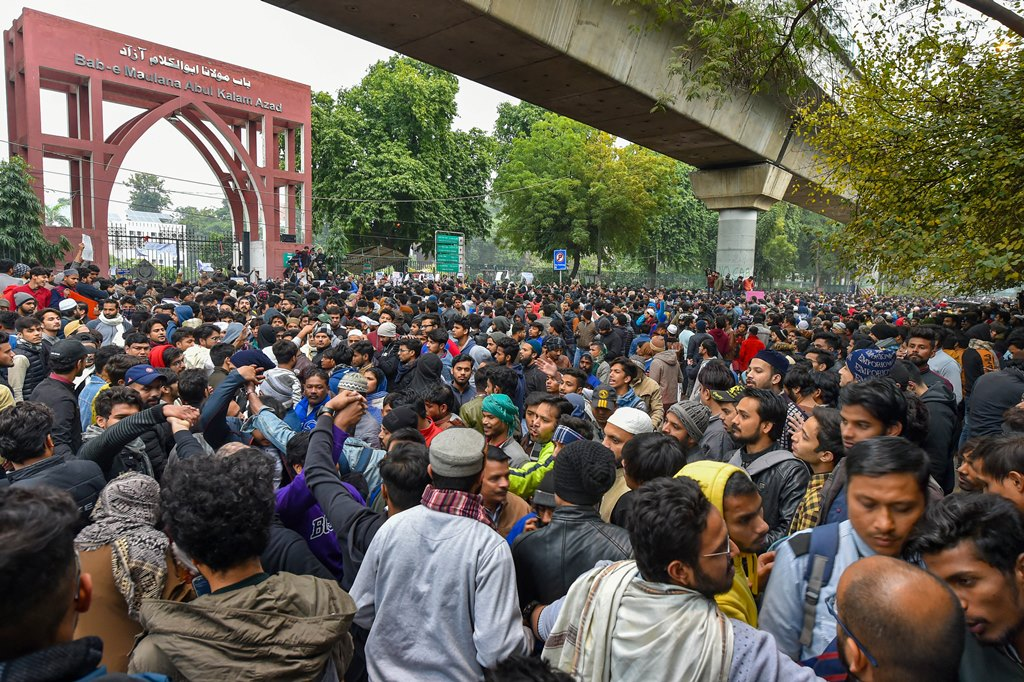 New Delhi: Students Jamia Millia Islamia gather for a protest against the Citizenship Amendment Act (CAA) and Sunday's alleged police crackdown in the University, in New Delhi, Monday, Dec. 16, 2019. (PTI Photo/Kamal Kishore) (PTI12_16_2019_000153B)