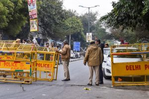 New Delhi: Tight police security at the Jawaharlal Nehru University (JNU), in New Delhi, Monday, Jan. 6, 2020. A group of masked men and women armed with sticks, rods and acid allegedly unleashed violence on the campus  of the University, Sunday evening. (PTI Photo/Atul Yadav) (PTI1_6_2020_000044B)