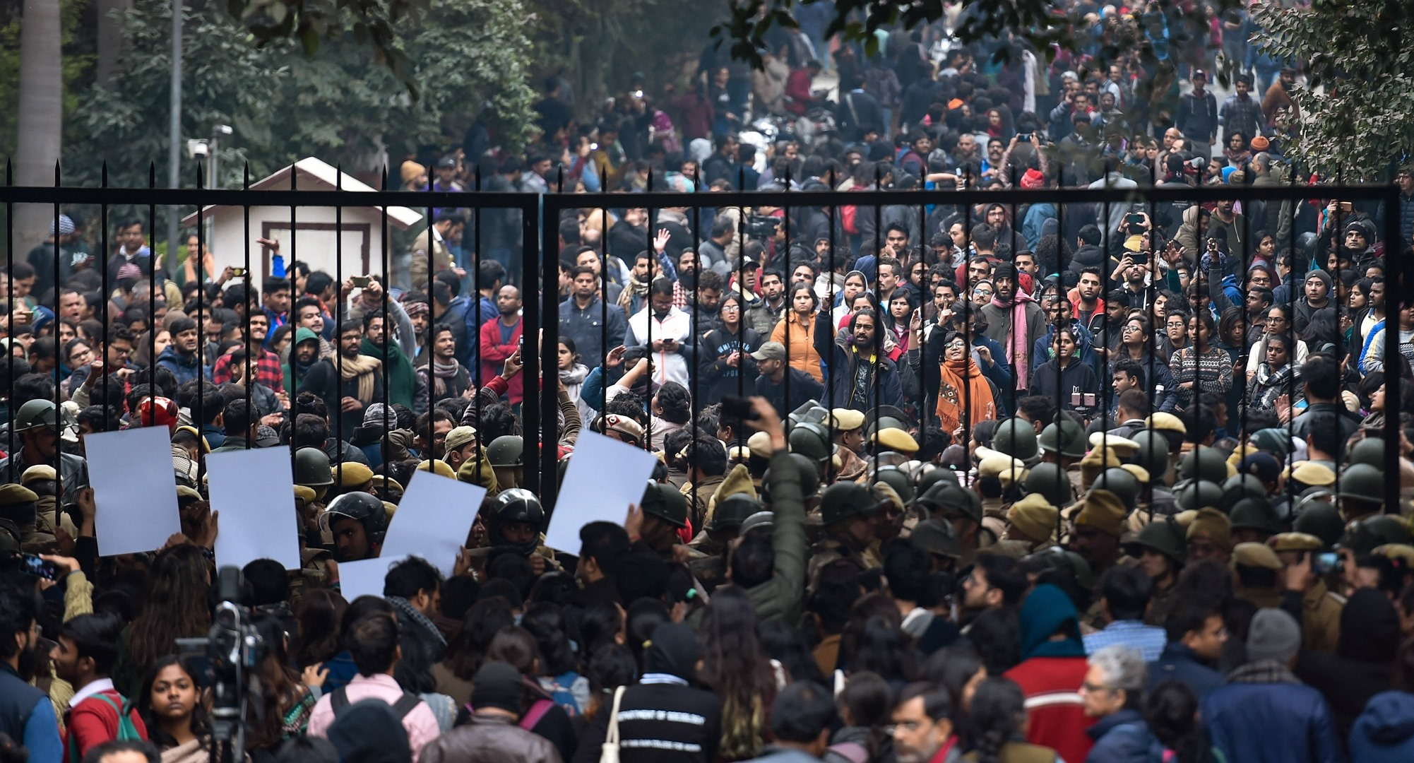 New Delhi: Students stage a protest at main Gate of JNU over Sunday's violence, in New Delhi, Monday, Jan. 6, 2020. A group of masked men and women armed with sticks, rods and acid allegedly unleashed violence on the campus of the University in New Delhi, Sunday evening.(PTI Photo/Atul Yadav)(PTI1_6_2020_000147B)