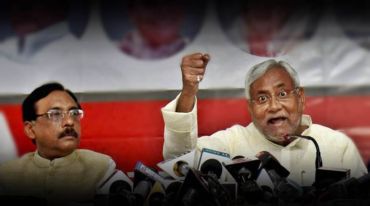 Patna: Bihar Chief Minister Nitish Kumar with party MP Pawan Verma and state persident Vashist Narayan addresses the media at JD(U) party office in Patna on Saturday. PTI Photo (PTI10_10_2015_000192B)