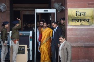 New Delhi: Union Finance Minister Nirmala Sitharaman, holding a folder containing the Union Budget documents, comes out of the Ministry of Finance along with her deputy Anurag Thakur and a team of officials, at North Block in New Delhi, Saturday, Feb. 1, 2020. (PTI Photo/Kamal Singh)   (PTI2_1_2020_000011B)