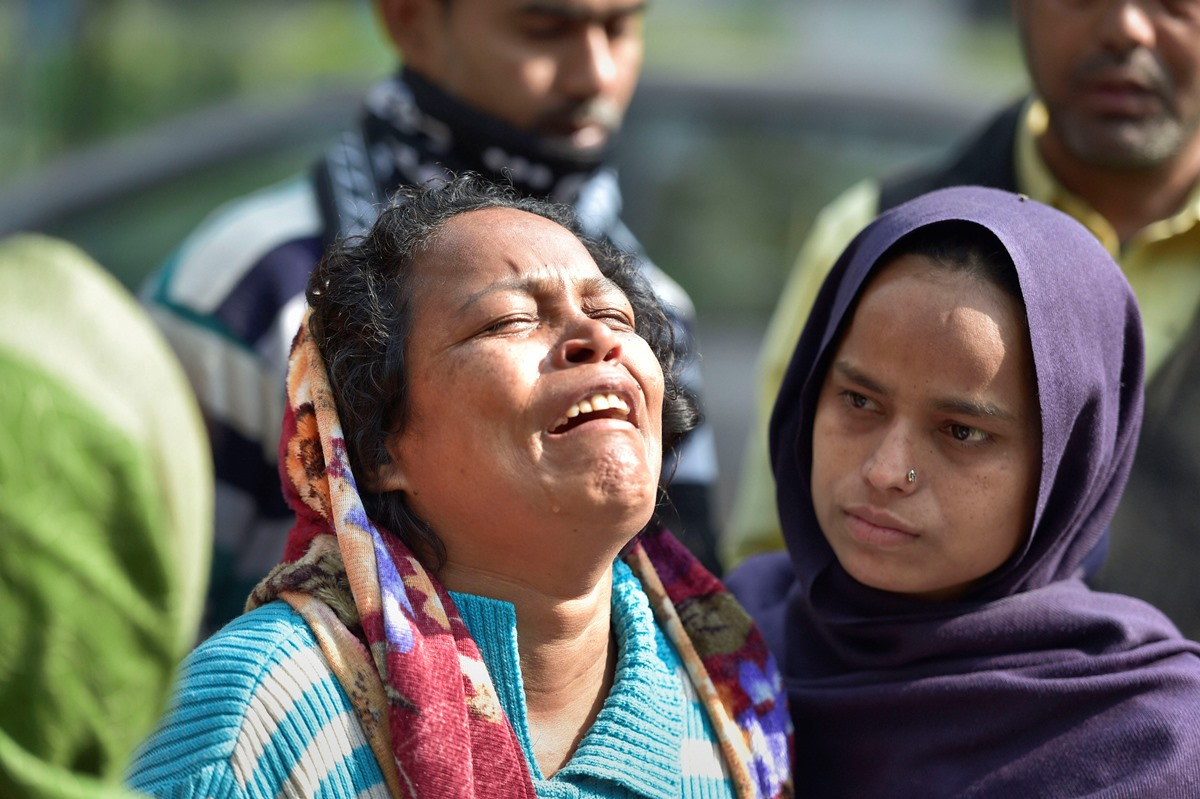 New Delhi: Mallika wife of Musharraf (33), who was killed during communal violence over the amended citizenship law, wails over the loss of her husband outside the mortuary of GTB hospital in New Delhi, Thursday, Feb 27, 2020. The death toll in the communal violence has reached 32 on Thursday. (PTI Photo/Vijay Verma)(PTI2_27_2020_000025B)