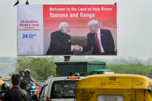 Agra: A billboard with the pictures of Prime Minister Narendra Modi and U. S. President Donald Trump put up along side a road, ahead of Trump's visit to Agra, Saturday, Feb. 22, 2020. (PTI Photo/ Kamal Kishore) (PTI2 22 2020 000034B)