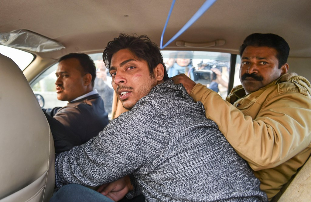 New Delhi: Police take away an unidentified person after he allegedly opened fire in the Shaheen Bagh area of New Delhi, Saturday, Feb. 1, 2020. Many anti-CAA protestors have been staging a peaceful demostration in the area for since Dec. 15, 2019. (PTI Photo/Arun Sharma) (PTI2_1_2020_000214B)