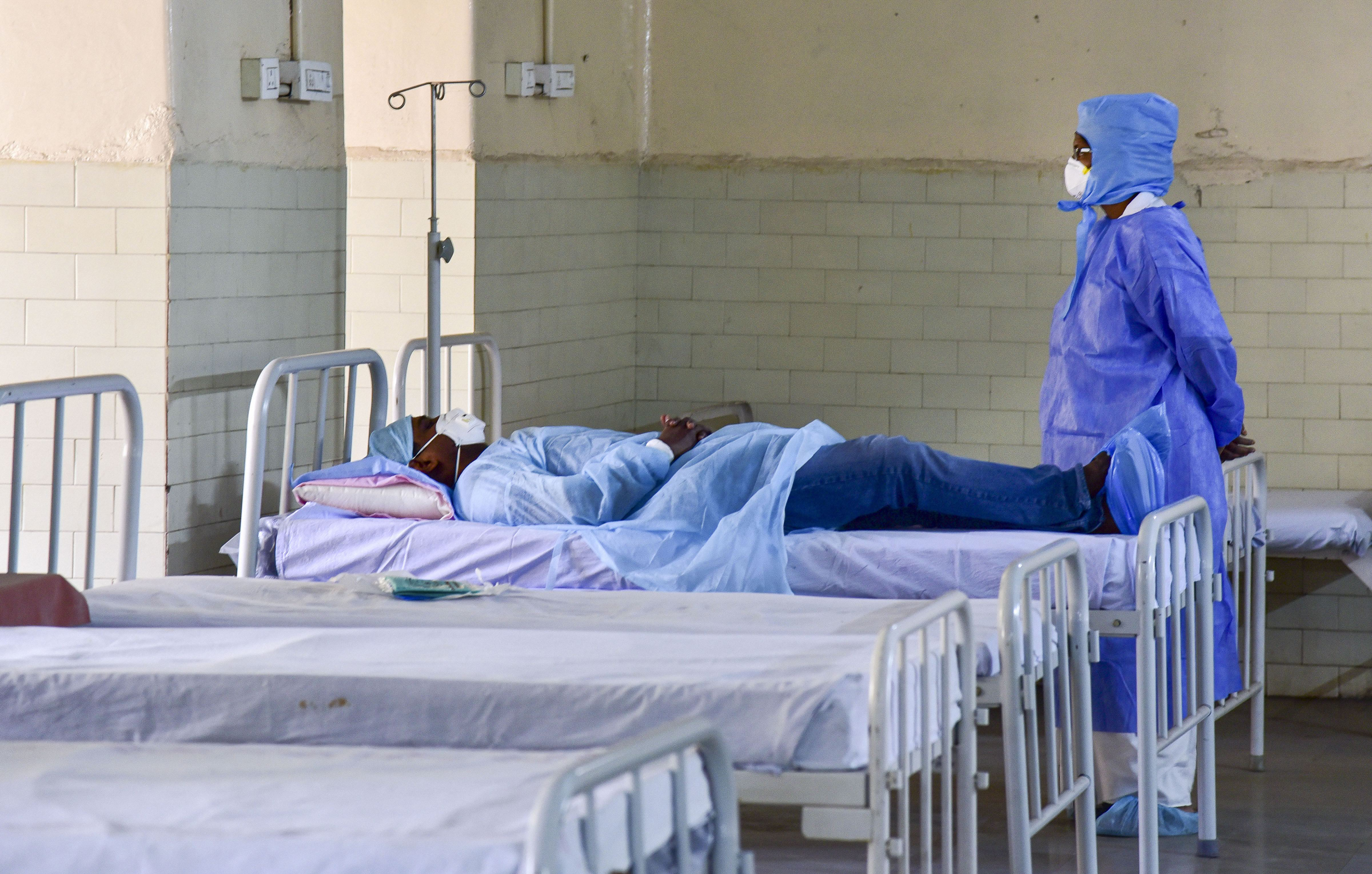 Hyderabad: A medic looks on at a patient who has shown positive symptoms for coronavirus (COVID -19) at an isolation ward in Hyderabad, Tuesday, March 10, 2020. (Credit: PTI)