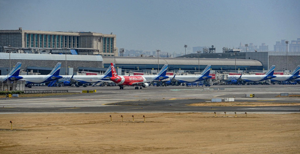 Mumbai: Aeroplanes parked on a runway at the airport, after all domestic and international flights were cancelled amid coronavirus pandemic, in Mumbai, Tuesday, March 24, 2020. (PTI Photo)