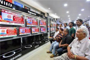Bikaner: People watch Prime Minister Narendra Modi's address to the nation on coronavirus pandemic in Bikaner, Thursday, March 19, 2020. (PTI Photo)(PTI19-03-2020_000246B)