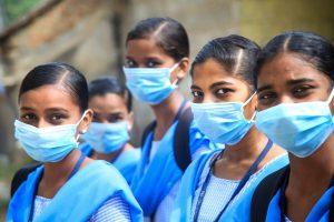 Kanyakumari: Students wearing maks in the wake of coronavirus pandemic pose for a photograph at Nagercoil in Kanyakumari district, Thursday, March 19, 2020. (PTI Photo)(PTI19-03-2020_000250B)