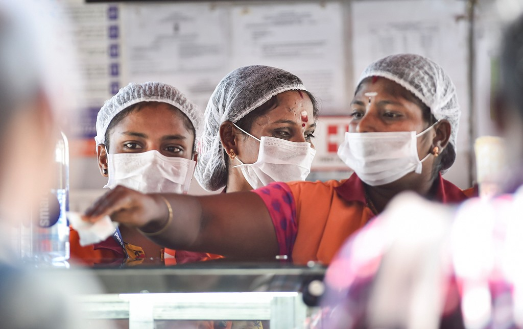 Chennai: Workers wear masks to protect themselves in the wake of deadly coronavirus, at Chennai airport, Tuesday, March 17, 2020. (PTI Photo/R Senthil Kumar)(PTI17-03-2020_000203B)