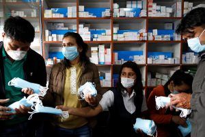 Employees sell face masks at a drug store as people gather to buy them amid concerns about the spread of coronavirus disease (COVID-19) outbreak, in Kathmandu(Reuters Photo)