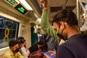 Passengers wear masks while travelling in a Delhi metro train as a prevention measure against coronavirus. (Photo: PTI)