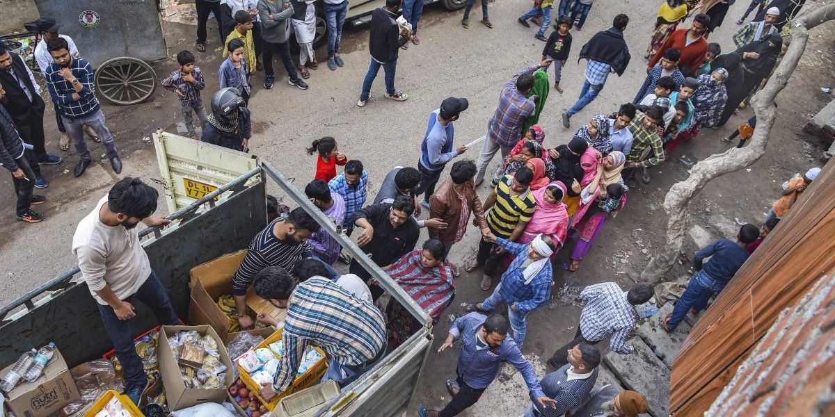 Civil society groups distribute relief material in riot-affected areas on Sunday, March 1st. Photo: PTI