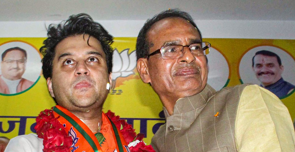 Bhopal: BJP leader Jyotiraditya Scindia being felicitated by party leader Shivraj Singh Chauhan, at party office in Bhopal, Thursday, March 12, 2020. (PTI Photo)(PTI12-03-2020_000214B)