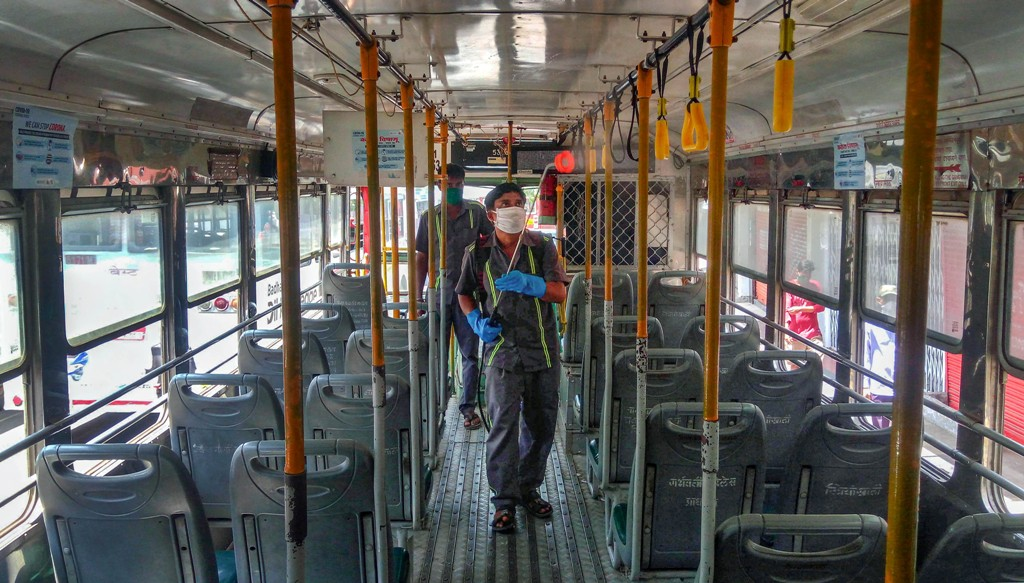 Mumbai: Municipal Corporation (BMC) worker sprays disinfectant inside a Brihanmumbai Electricity Supply and Transport (BEST) bus, during the nationwide lockdown in the wake of the coronavirus pandemic, at Borivali in Mumbai, Wednesday, April 8, 2020. (PTI Photo) (PTI08-04-2020 000218B)