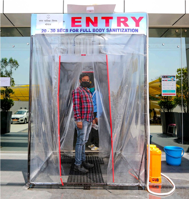 A man is seen inside a full-body sanitization machine, installed by BMC in Smart city control room amid a nationwide lockdown in the wake of coronavirus pandemic, in Bhopal, Saturday, April 4, 2020. (PTI Photo-50-6353871/
