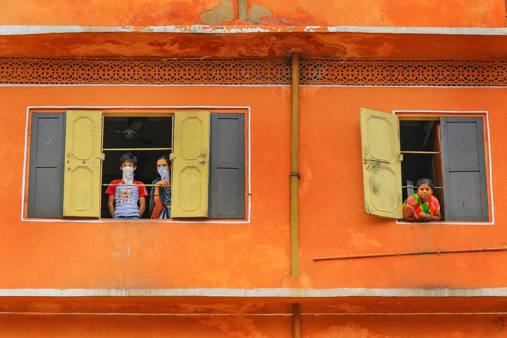 Jaipur: Residents look out from their windows, during the nationwide lockdown to curb the spread of coronavirus, in Jaipur, Thursday, April 23, 2020. (PTI Photo)(PTI23-04-2020_000167B)