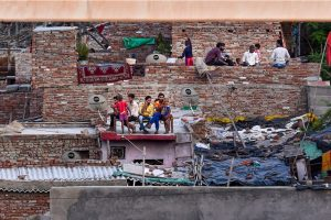 New Delhi: Family members sit on the rooftop of their houses during the nationwide lockdown, imposed in wake of the coronavirus pandemic, in New Delhi, Tuesday, April 21, 2020. (PTI Photo/Atul Yadav)(PTI21-04-2020 000240B)