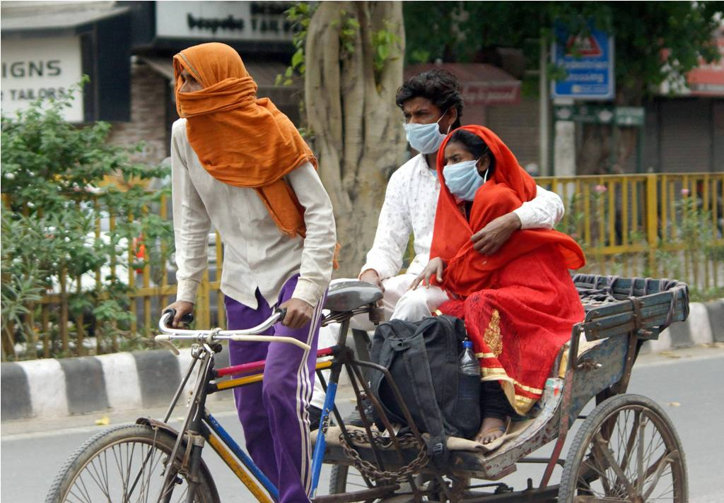New Delhi: A sick woman being taken to a hospital on a rickshaw, during the nationwide lockdown to curb the spread of coronavirus, in Old Delhi, Thursday, April 23, 2020. (PTI Photo/Kamal Kishore)(PTI23-04-2020 000107B)