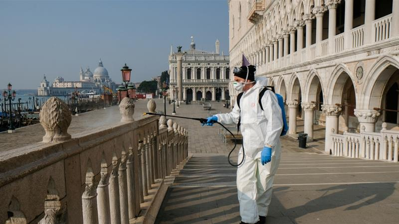 A worker sanitises Ponte della Paglia bridge on St. Mark's square as a measure to fight against the coronavirus contagion in Venice, Italy [Manuel Silverstri/Reuters]