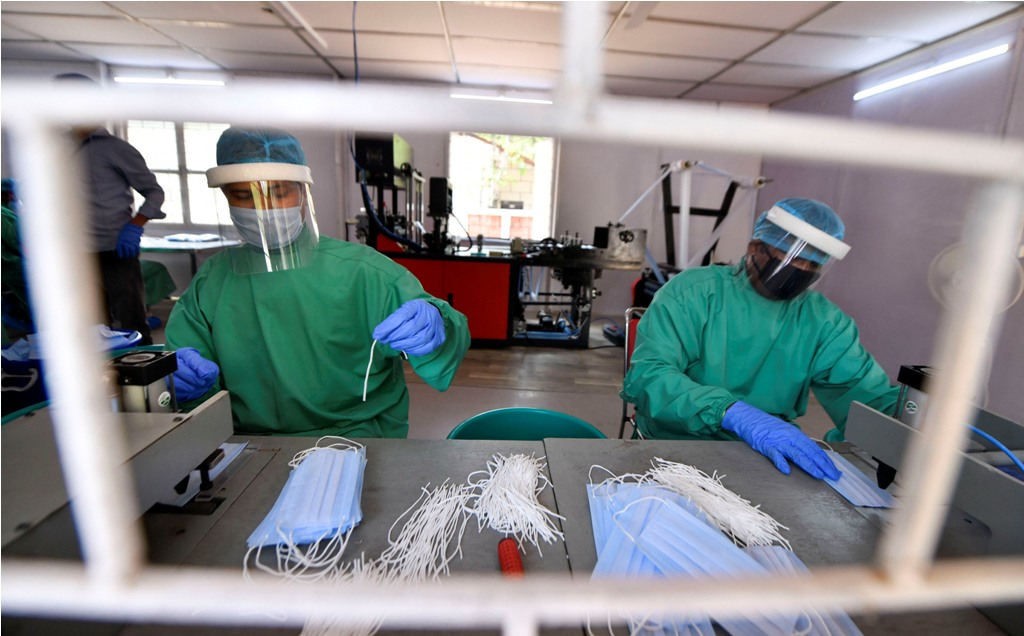 New Delhi: Central Reserve Police Force (CRPF) personnel manufacture personal protective equipments (PPE) during the nationwide lockdown to curb the spread of coronavirus, in New Delhi, Friday, April 10, 2020. (PTI Photo/Ravi Choudhary)(PTI10-04-2020_000098B)